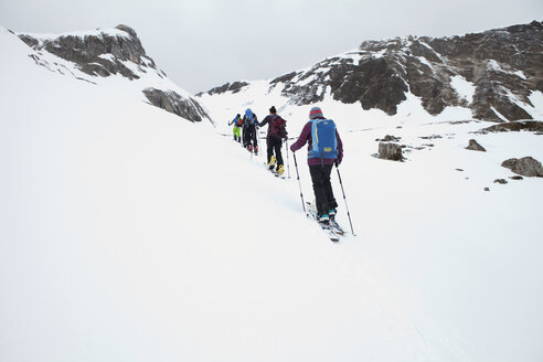Austria, Tyrol, Hintertux glacier, people ski mountaineering with splitboards - FA000069