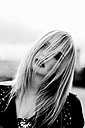 Blond woman with strand of hair on her face - DAWF000216