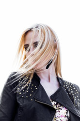 Portrait of blond woman with hair in her face - DAWF000210