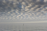 Germany, Baltic Sea, sailing boat resting at the sea under cloudy sky - MELF000035