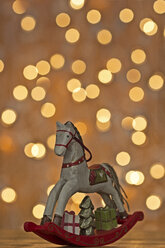 Christmas rocking horse in front of points of light - MELF000032