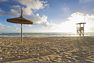 Spain, Baleares, Mallorca, view to empty beach with beach umbrella and attendant's tower - MSF004326