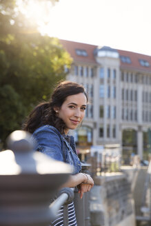 Germany, Berlin, portrait of young female tourist on city trip - FKF000705