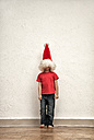 Little boy's face hiding under oversized Christmas cap - MMFF000403