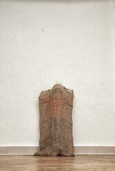 Little boy hiding in gunny bag - MMFF000400