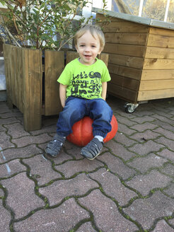 Little Boy sitting on pumpkin - AFF000124
