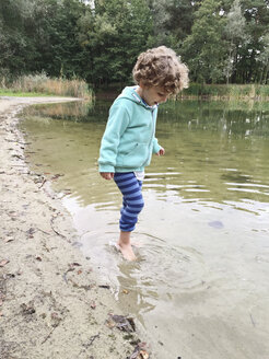 Boy wading in water - AFF000140