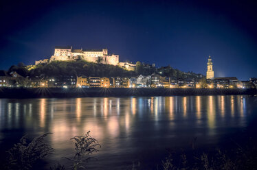 Germany, Bavaria, Burghausen, View to Old town with castle complex at Salzach river at night - OPF000022