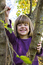 Portrait of grinning little girl in autumnal forest - LVF002081