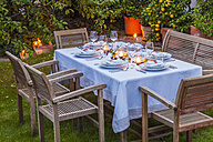 Autumnal laid table in garden in the evening - WDF002731