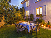 Autumnal laid table in garden in the evening - WDF002734