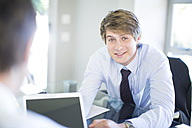 Smiling young businessman in office - ZEF002229