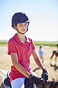 Portrait of confident girl on horse - ZEF001716