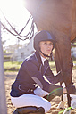 Young woman with horse on show jumping course - ZEF001767