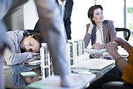 Woman sleeping during a business meeting - ZEF002176