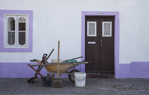 Portugal, Algarve, Tavira, Wheelbarrow in front of a house - KBF000224