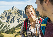 Austria, Tyrol, Tannheimer Tal, smiling young couple hiking - UUF002426