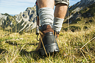 Austria, Tyrol, Tannheimer Tal, close-up of young couple hiking - UUF002433