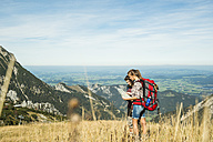 Austria, Tyrol, Tannheimer Tal, young hikers looking at map - UUF002439