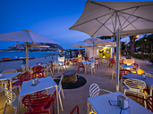 Italy, Sicily, Province of Palermo, Mondello, Restaurant in the evening - AM003119