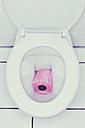 Pink toilet paper in toilet - UWF000217