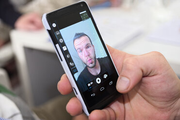 Selfie of young man on cell phone display - LAF001182