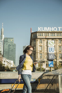 Germany, Frankfurt, young businesswoman on the move in city center - UUF002507