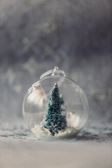 Christmas bauble made of glass with fir tree and artificial snow inside - JPF000017