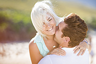 Young couple embracing on the beach - ZEF002368