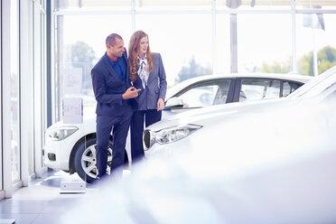 Smiling couple at car dealer - ZEF002018