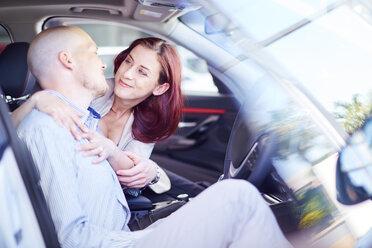 Couple at car dealer inside car - ZEF002032