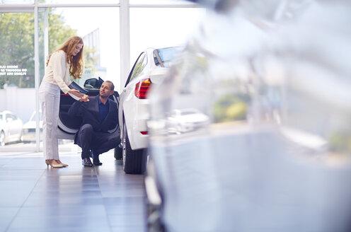 Couple at car dealer - ZEF002042