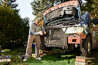 Man working at old van outdoors - BFRF000645