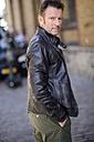Portrait of man wearing black leather jacket - GUFF000052