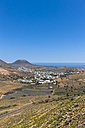 Spain, Canary Islands, Lanzarote, Maguez, Village Haria and Volcano Monte Corona in the background - AMF003169