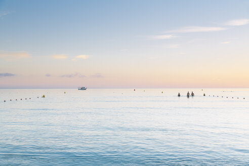 Spain, Balearic Islands, Majorca, Three people swimming in the sea - MSF004338