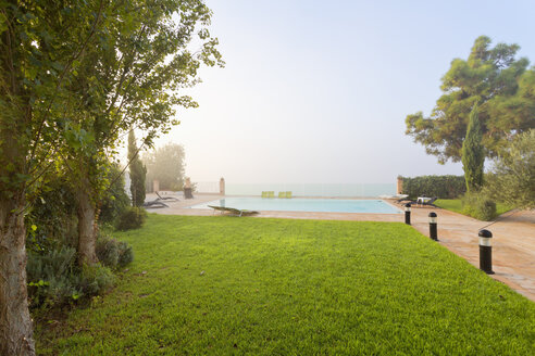 Spain, Balearic Islands, Majorca, Swimming pool of a hotel - MSF004376