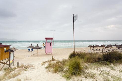 Spain, Balearic Islands, Majorca, one teenage boy climbing on a lifeguard stand - MSF004361