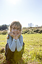 Smiling girl crouching on a meadow - OJF000060