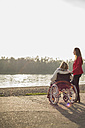 Granddaughter assisting her grandmother sitting in wheelchair - UUF002590