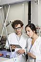 Scientists working with tablet computer in analytical laboratory - FKF000883