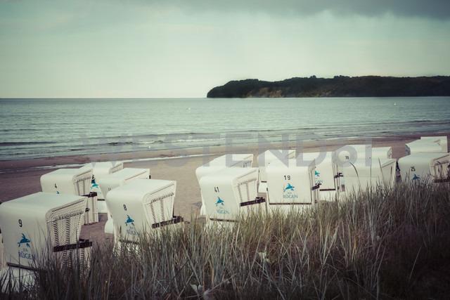 Germany, Mecklenburg-Western Pomerania, Ruegen, Binz, hooded beach chairs at twilight - MAB000256