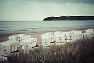 Germany, Mecklenburg-Western Pomerania, Ruegen, Binz, hooded beach chairs at twilight - MAB000256