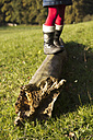 Germany, Bavaria, Landshut, girl balancing on log - YFF000261