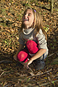Germany, Bavaria, Landshut, happy girl in autumnal forest - YFF000263