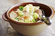 Vegetarian stew with savoy cabbage, parsnips, potatoes, apples and vegan tofu sausage - HAWF000503