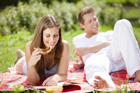 Happy couple having a picnic in park - CvK000197