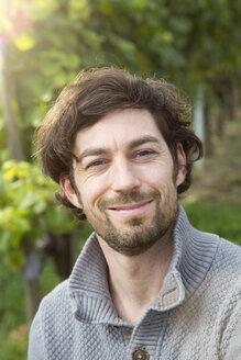 Germany, Bavaria, Volkach, portrait of winegrower in vineyard - FKF000805