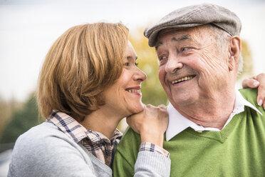 Confident senior man with daughter outdoors - UUF002643