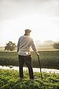 Senior man standing in rural landscape - UUF002698